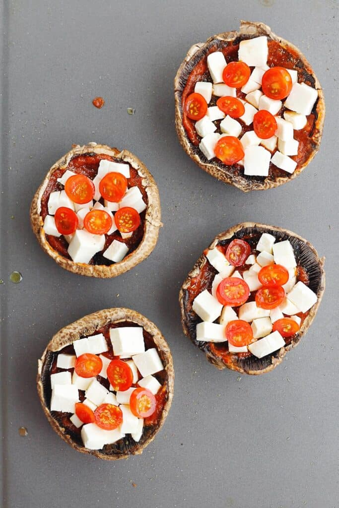 Portobello mushroom cap pizzas with tomato