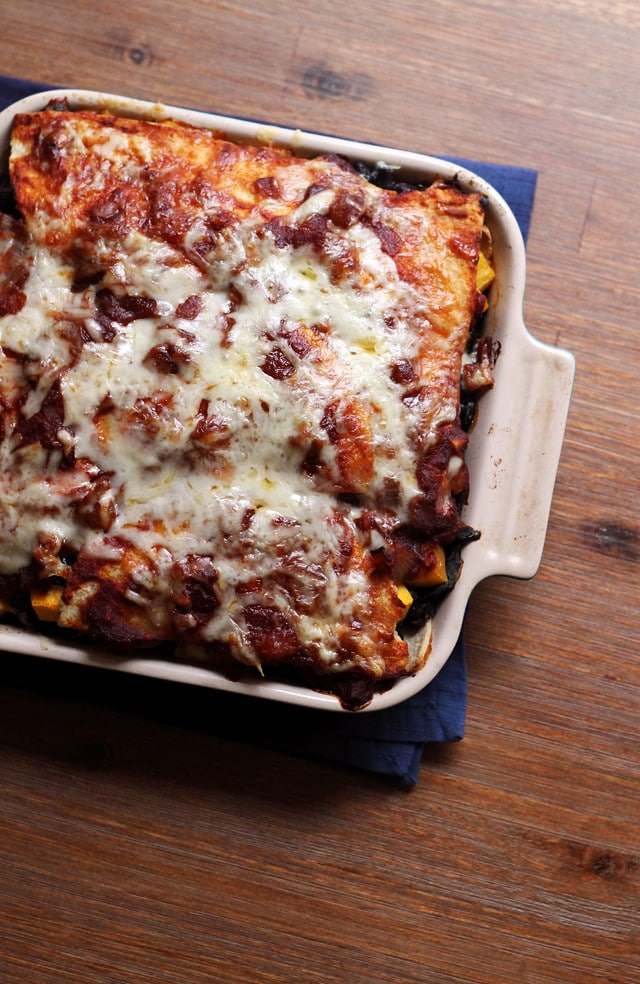 Butternut squash enchilada casserole topped with cheese