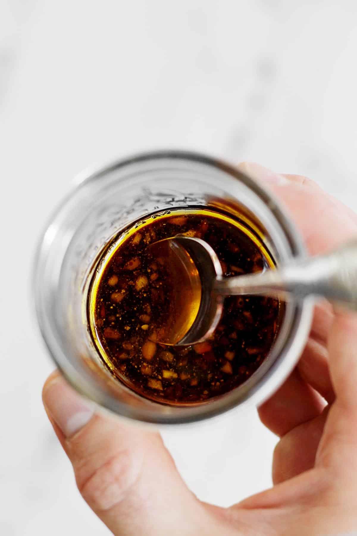 Balsamic vinaigrette in a mason jar with a spoon
