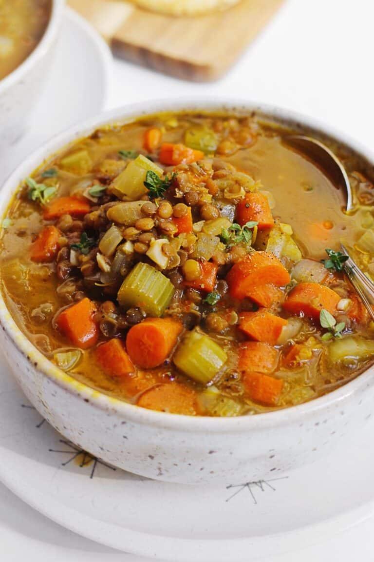 Pumpkin lentil soup with a spoon