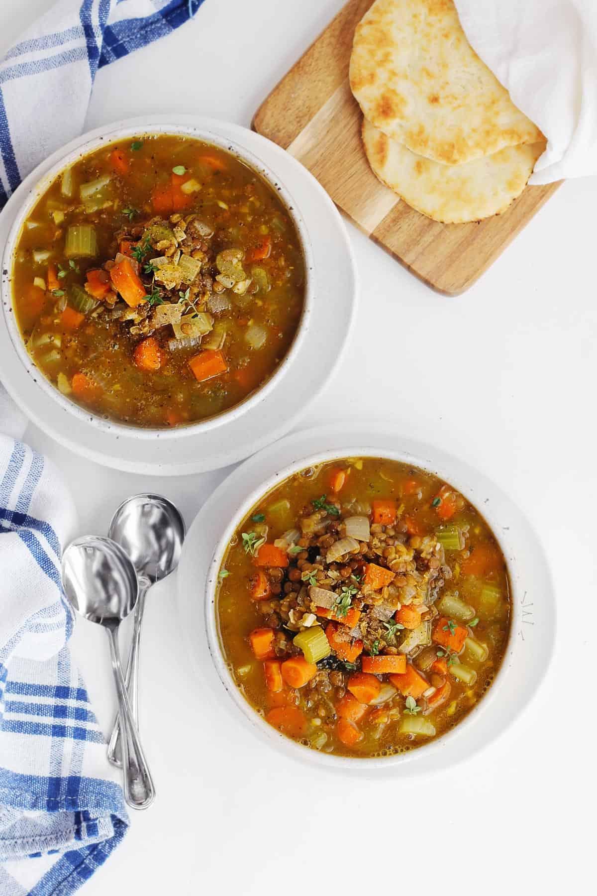 fall pumpkin lentil stew in two bowls