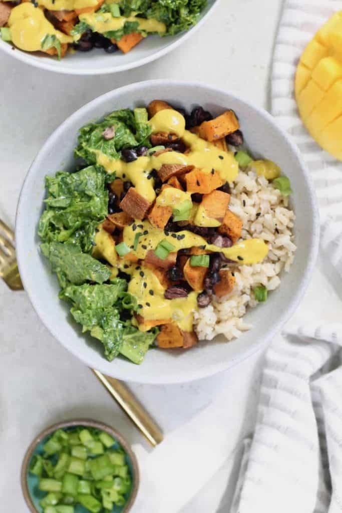 sweet potato black bean buddha bowls with yellow sauce and rice
