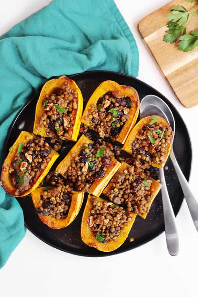Vegetarian Thanksgiving stuffed squash on a black plate