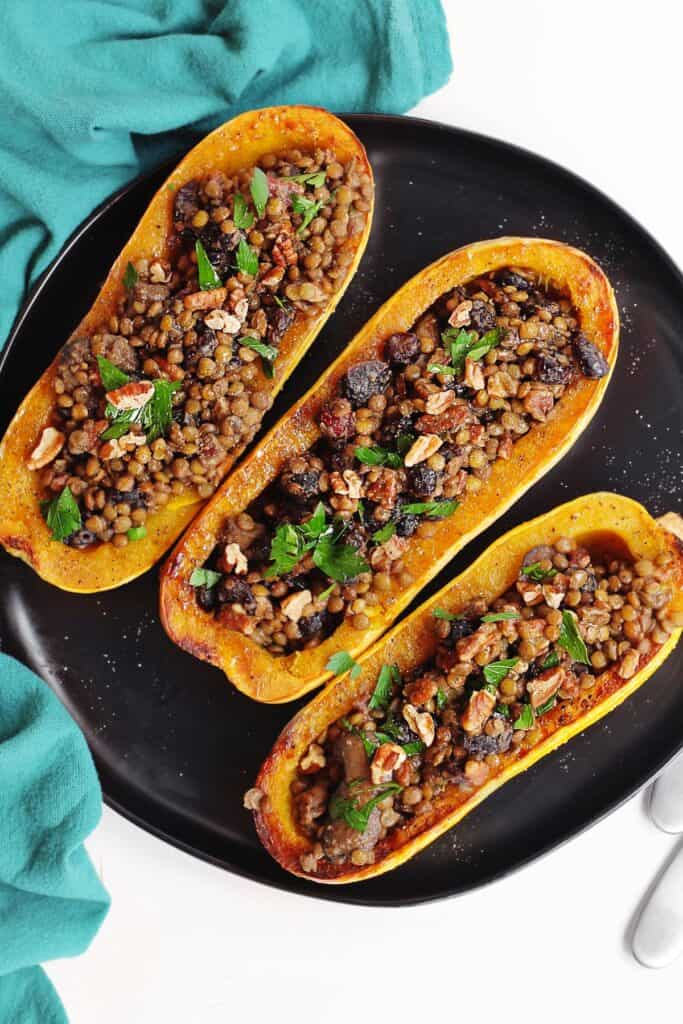 Vegan holiday delicata squash on a black plate