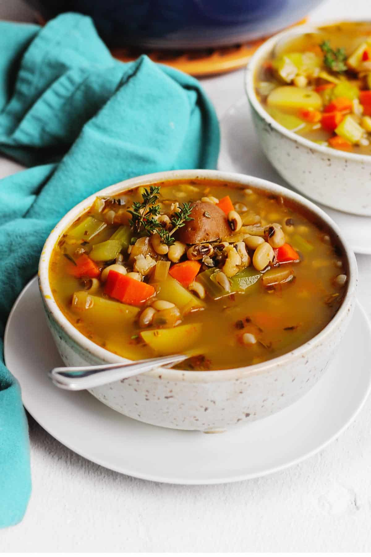 Vegan black eyed pea soup with a spoon
