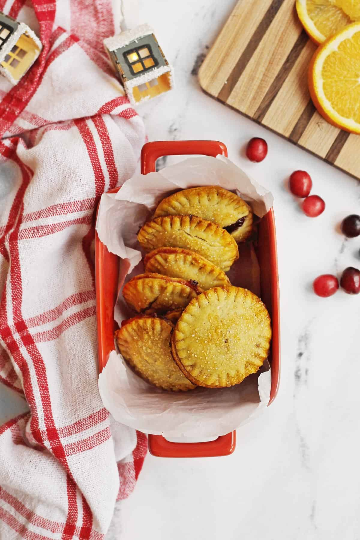 Cranberry orange hand pies in a red pan