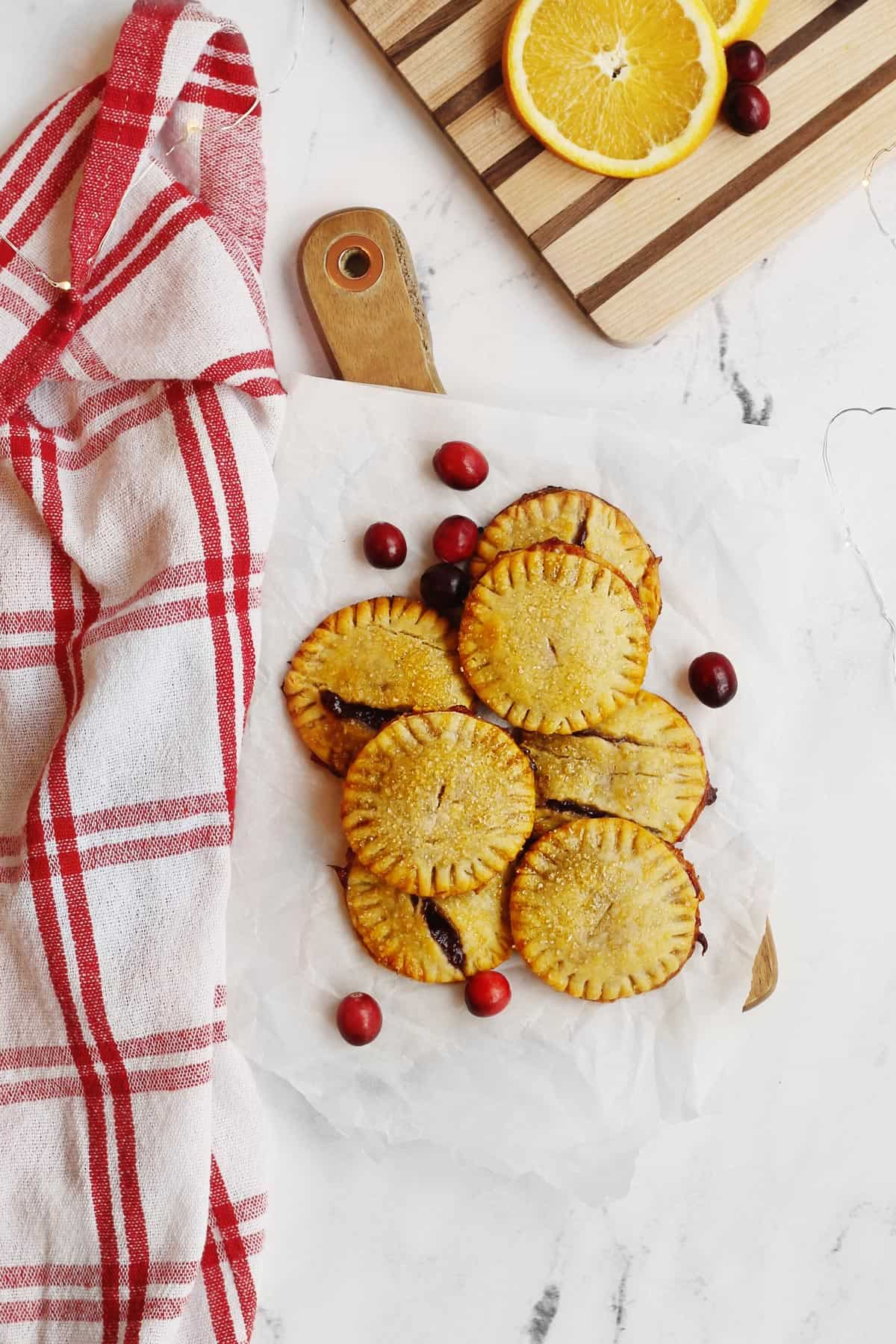 Cranberry hand pies on a cutting board