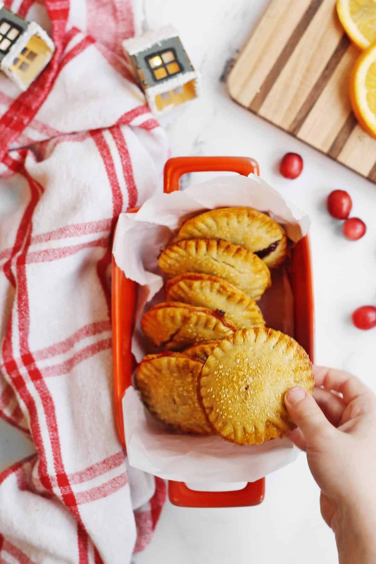 Holiday hand pies with a red and white linen