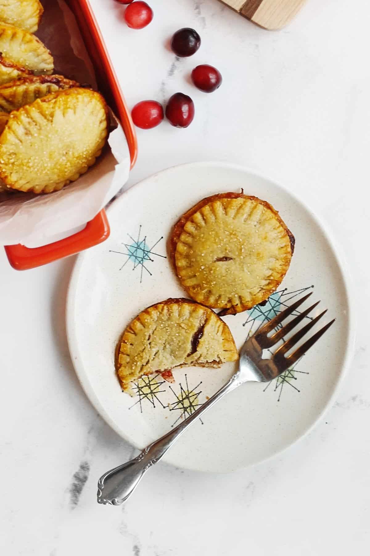 Cranberry orange hand pies on a plate