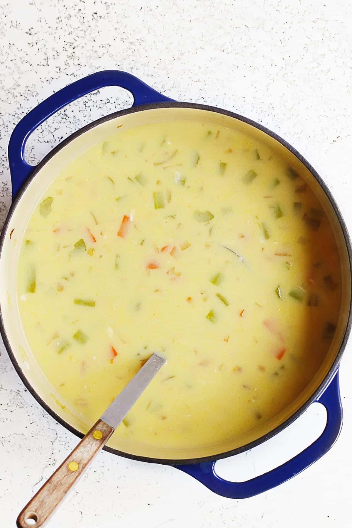 Lemon orzo soup in a pot