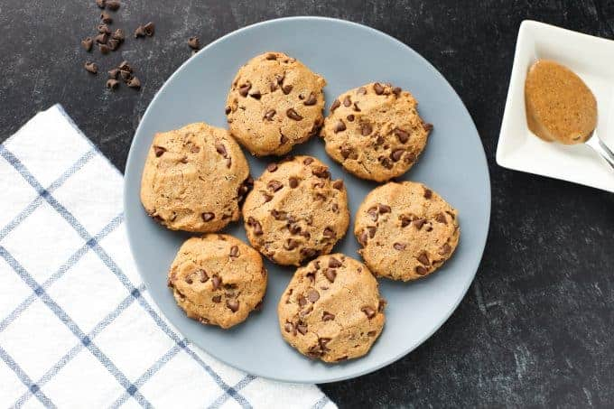 Chocolate chip almond butter cookies on a blue plate