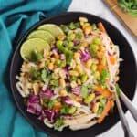 Peanut noodle salad in a black bowl
