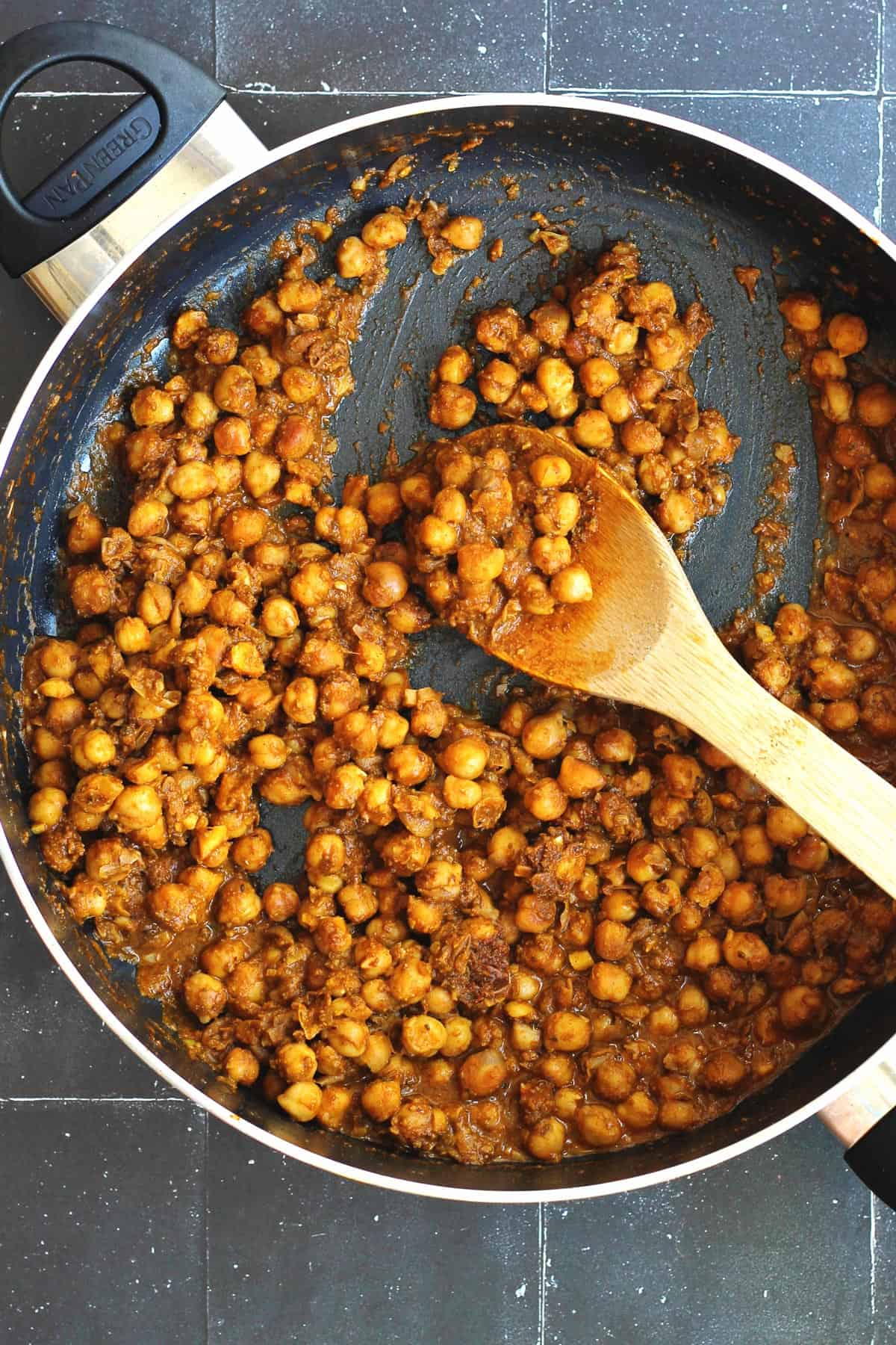 Cooking chickpeas in a pan for chickpea gyros