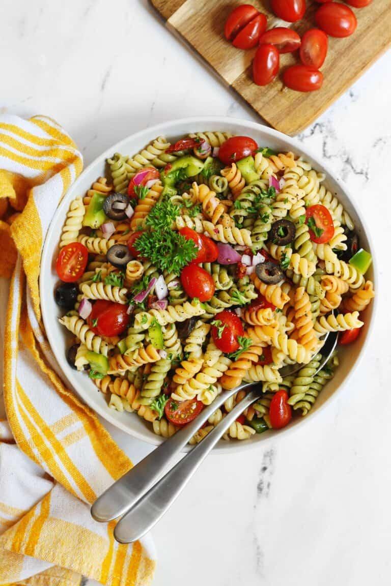 Vegan pasta salad with 2 spoons