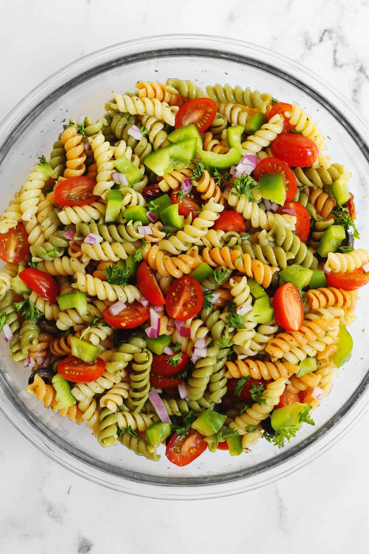 Vegetarian pasta salad in a large glass bowl