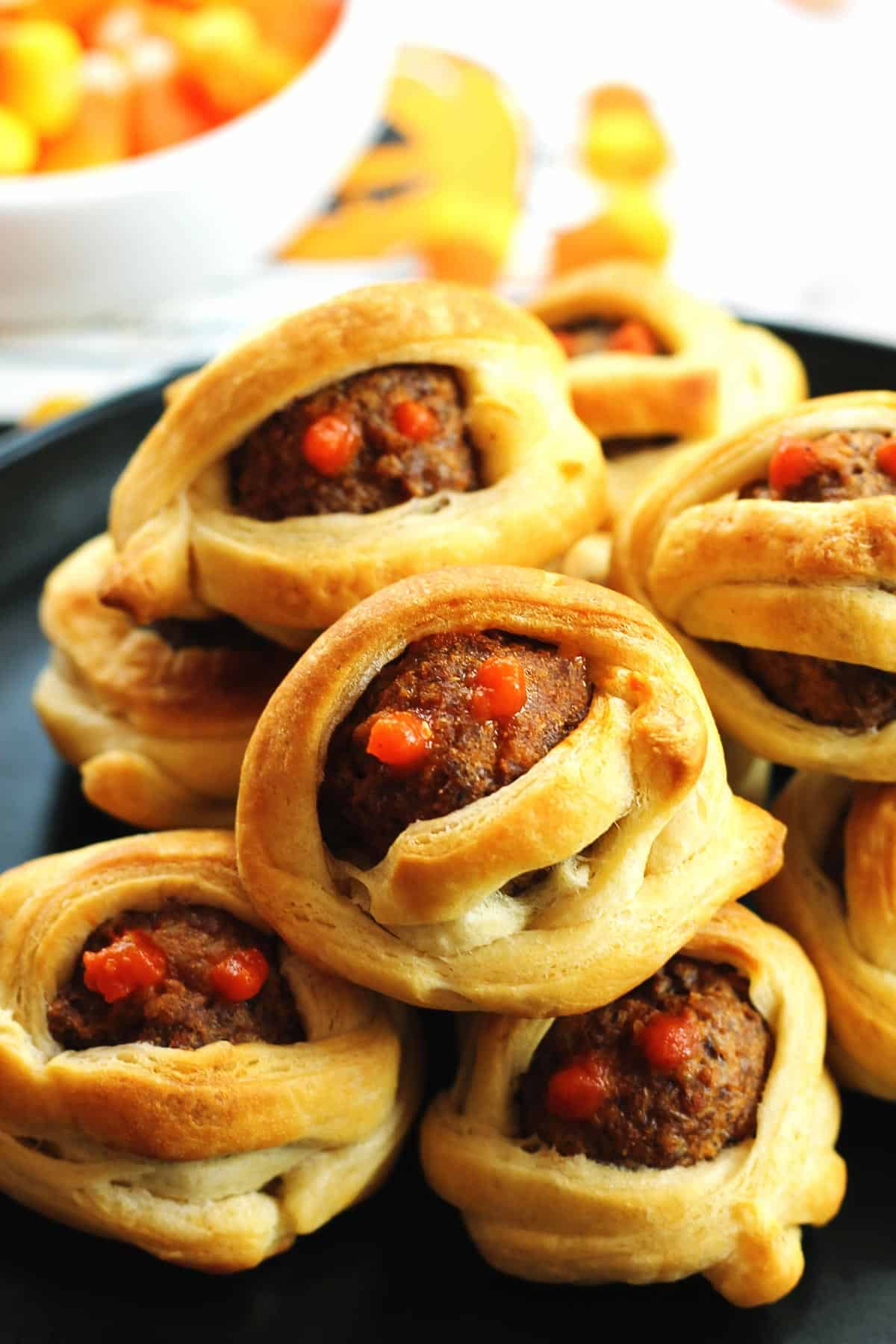 Mummy meatballs with red eyes