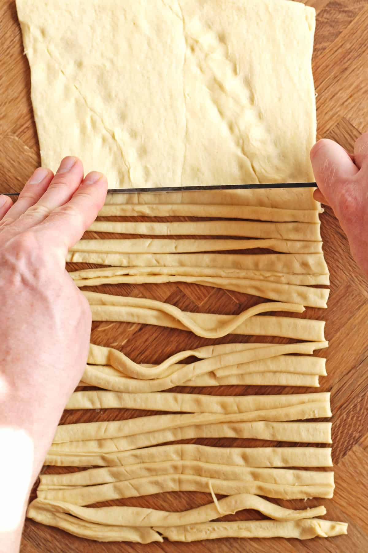 Strips of crescent dough cut with a knife