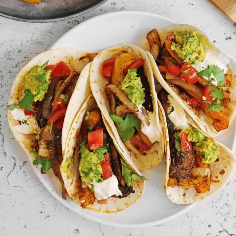 Vegetarian fajitas on a white plate