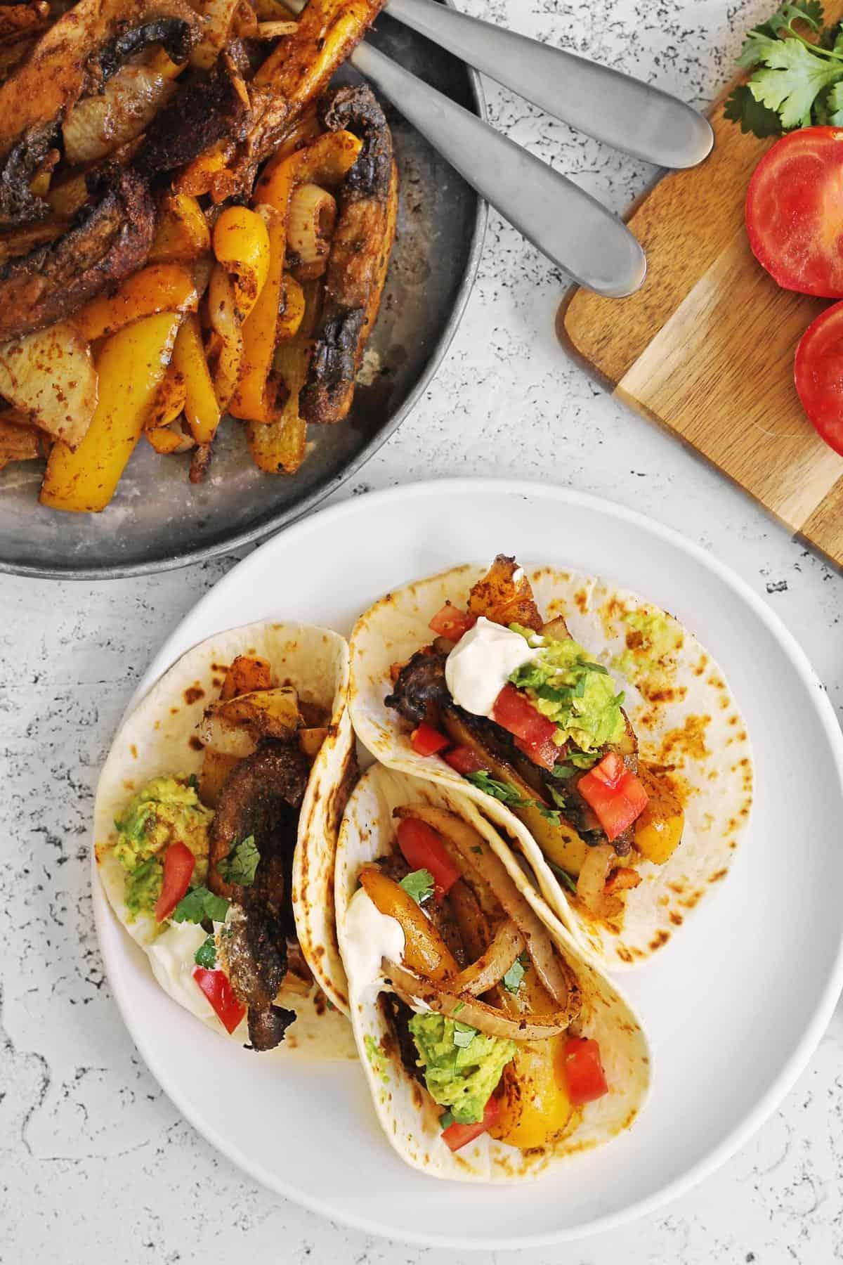 Vegan fajitas on a white plate