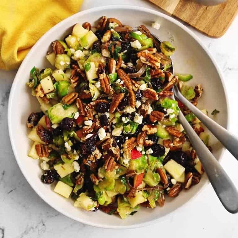 Brussels sprout salad with two serving spoons