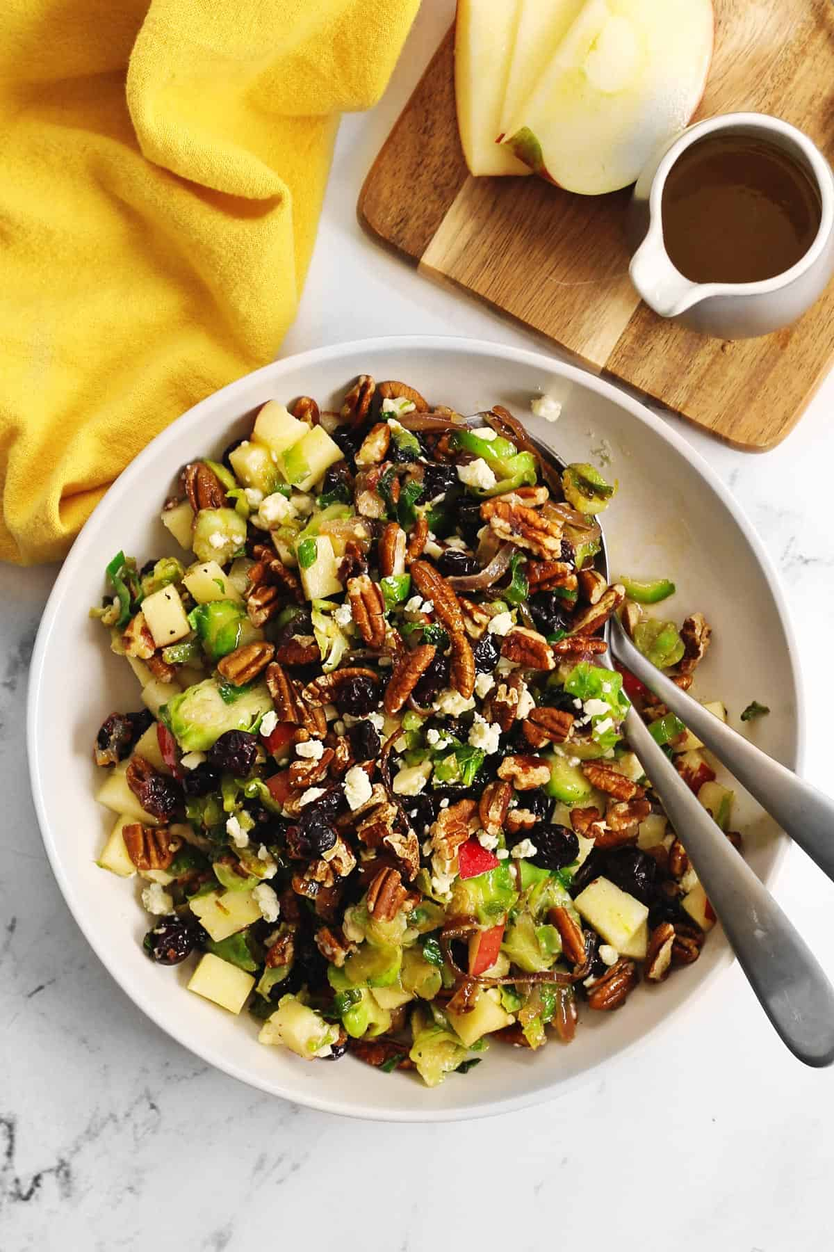 Shaved brussels sprout salad with two serving spoons