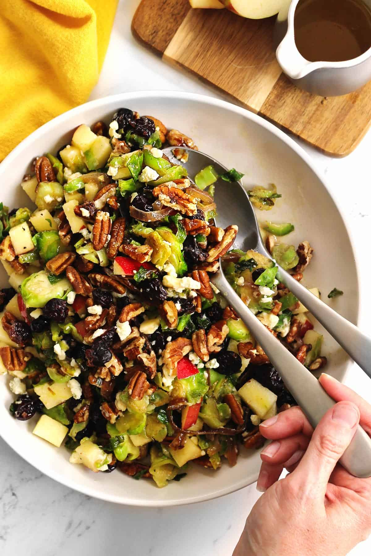 Warm brussels sprout salad being scooped with a spoon