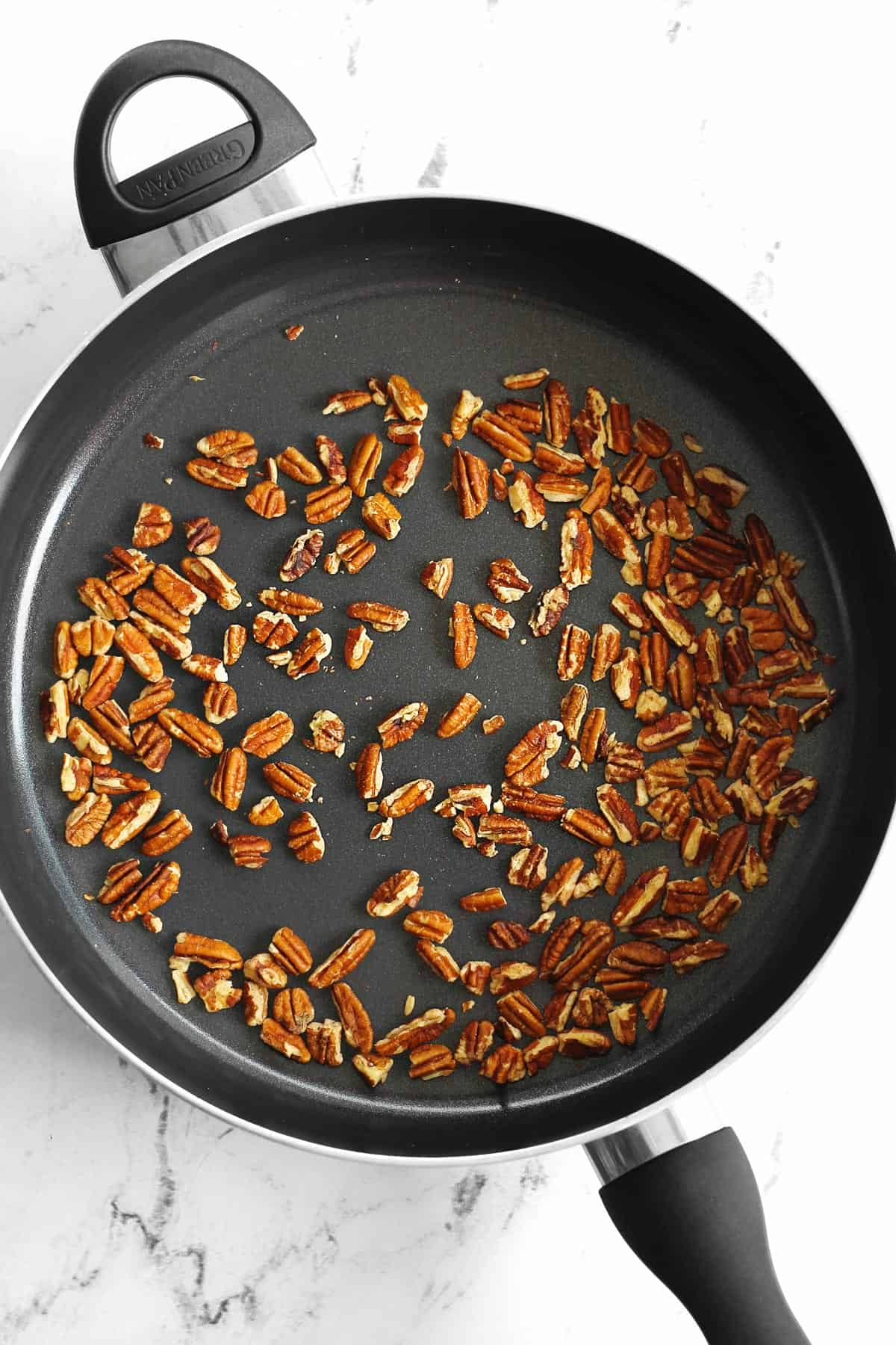 Toasted pecans in a skillet