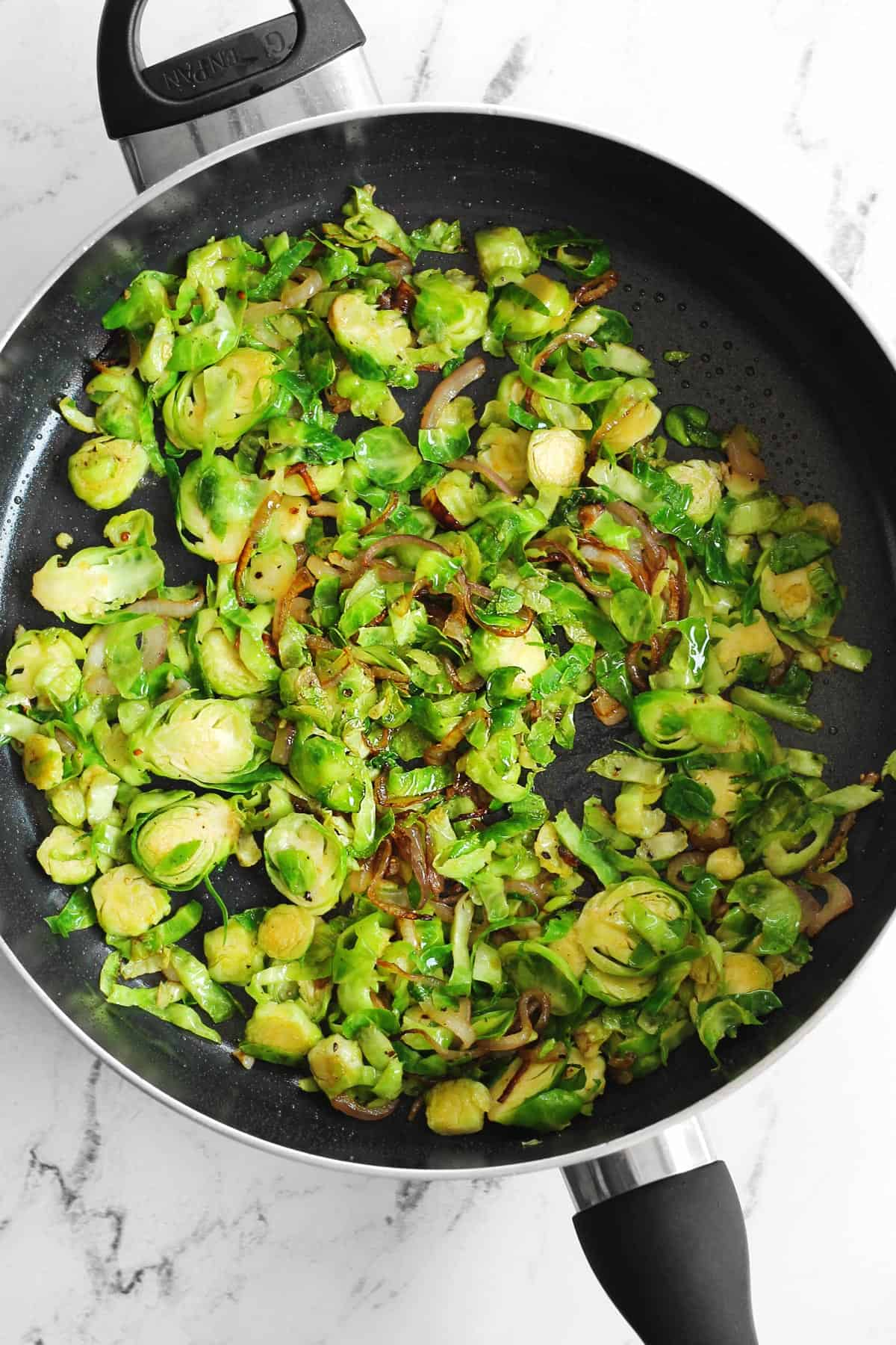 Warm brussels sprouts in a skillet
