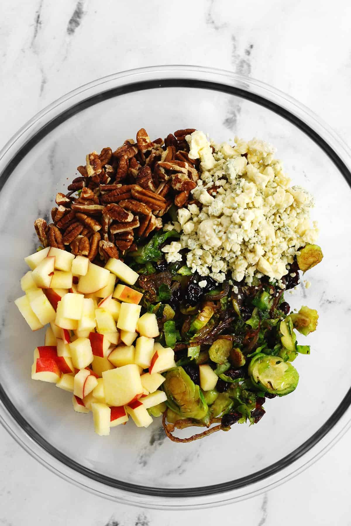 Brussels sprout and apple salad in a glass bowl