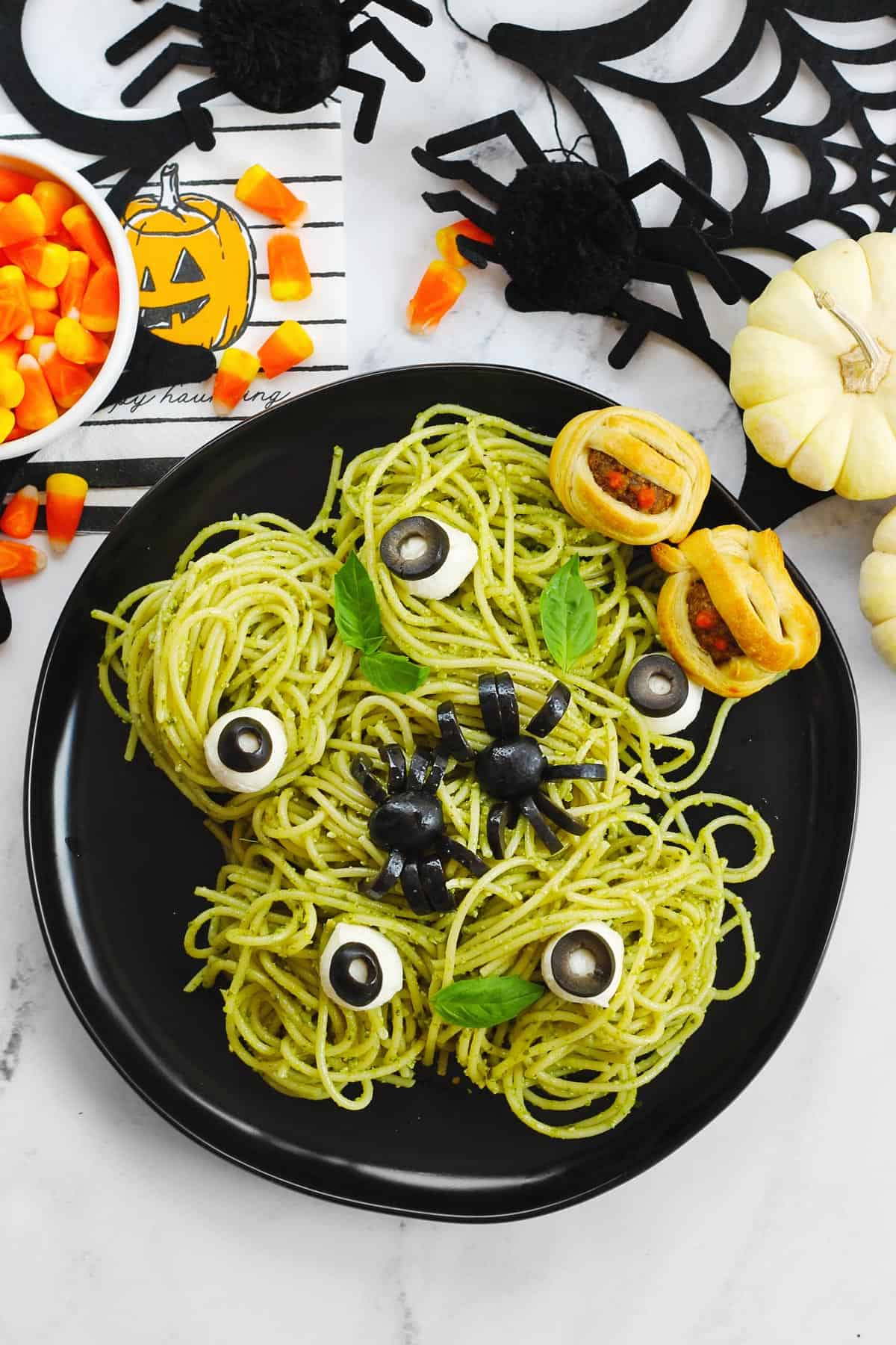 Spooky spaghetti with eyeballs and spiders