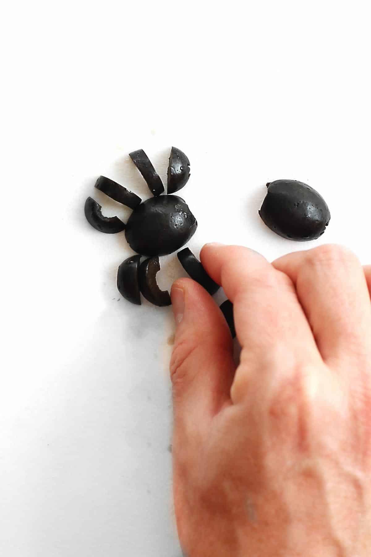 Making black olive spiders